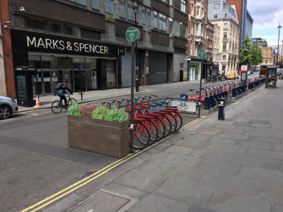 Mobility Corral installed quickly and easily on street with custom front panels